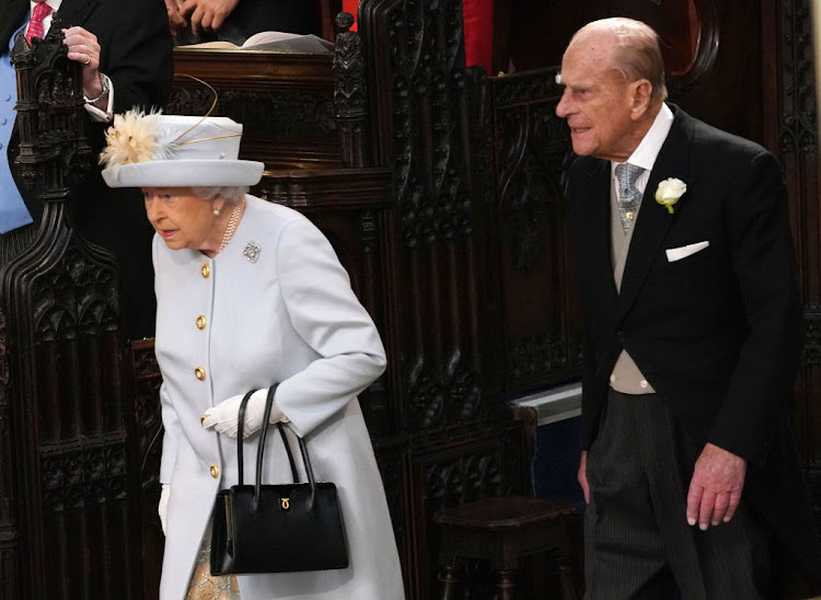 Queen Elizabeth II and Prince Philip, Duke of Edinburgh, arrive at St George's chapel for their granddaughter, Princess Eugenie's wedding.