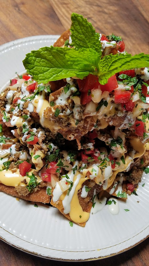 Expatriate Nachos, available at brunch Sat Sun 10am - 2pm and early and late night on weekdays only (between 5-6 pm or after 10 pm only). Fried wonton chips, thai chili cheese sauce, spicy lemongrass beef, crema, kaffir lime & tomato salsa, herbs