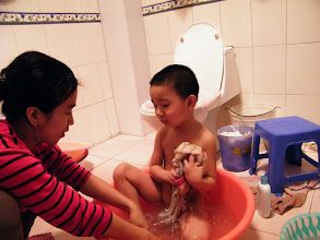 Photo: baby in bath with his mom.