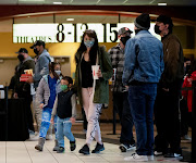 Moviegoers are pictured at a AMC theatre on reopening day during the outbreak of the coronavirus disease (Covid-19), in Burbank, California, US, March 15, 2021.