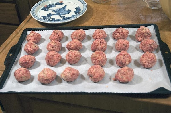 Make meatballs using 1 ounce of mixture, and place them on a parchment-lined baking...