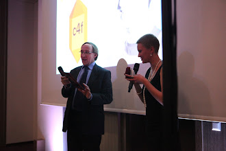 """Photo: James Gillies, presenting the 2012 C4F award winner of """"Relations of the Future"""""""