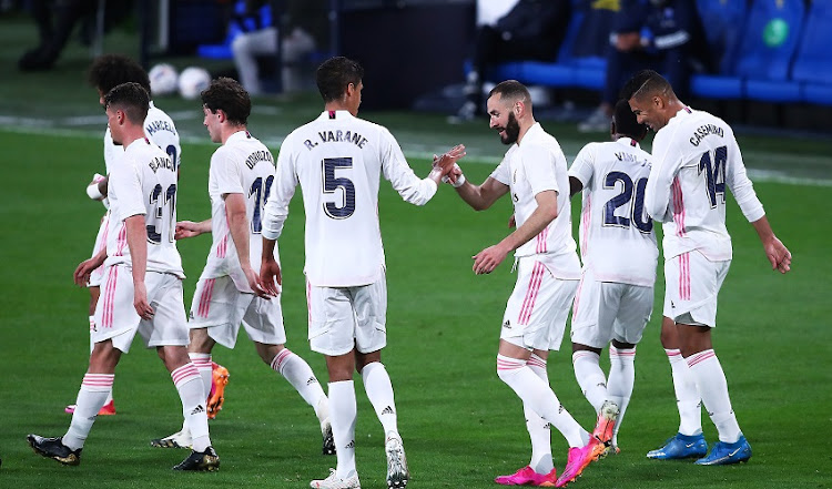 Karim Benzema of Real Madrid celebrates scoring a goal with team mates during the La Liga Santander match between Cadiz CF and Real Madrid at Estadio Ramon de Carranza on April 21, 2021 in Cadiz, Spain.