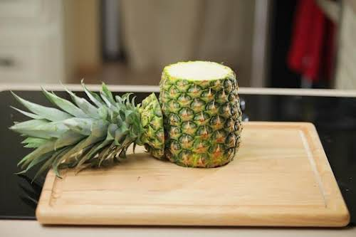 Step 1. Cut bottom and top off pineapple with a sharp knife.
