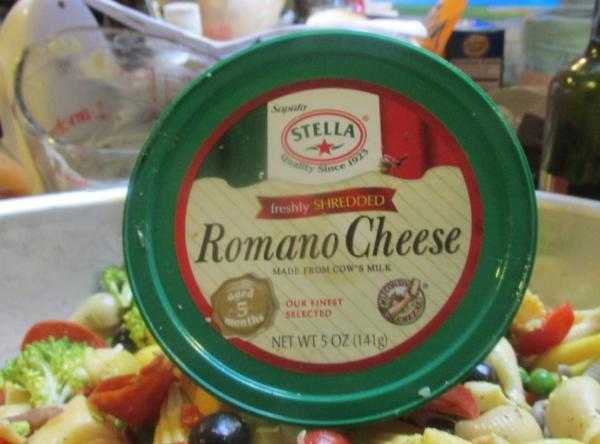 Sprinkle in the Romano cheese into the salad bowl.