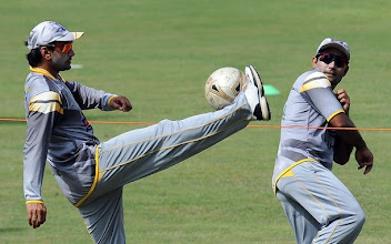 Photo: Pakistan cricketer Mohammad Hafeez (L) plays football with teammate Asad Shafiq during a practice session at the R. Premadasa Stadium in Colombo on June 15, 2012.  The remaining two matches in the one-day series between Sri Lanka and Pakistan will have reserve days due to rains in the country, Sri Lanka Cricket (SLC) announced. The last two day-night games of the five-match series are scheduled to be played in Colombo on June 16 and 18 with rain forecast for both days.   AFP PHOTO/ LAKRUWAN WANNIARACHCHI        (Photo credit should read LAKRUWAN WANNIARACHCHI/AFP/GettyImages)