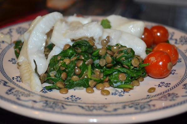 Serve by placing lentil mixture on a plate and putting fish on top.