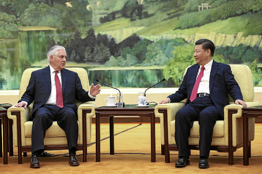 Cordial relations: Chinese President Xi Jinping, right, talks to US Secretary of State Rex Tillerson at the Great Hall of the People on Sunday in Beijing. Picture: REUTERS