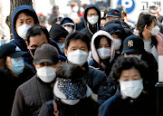 Images of people wearing masks and looking like they are from an alien planet can only feed into the growing blaming of people of other cultures and races for coronavirus.  /REUTERS/Kim Kyung-Hoon