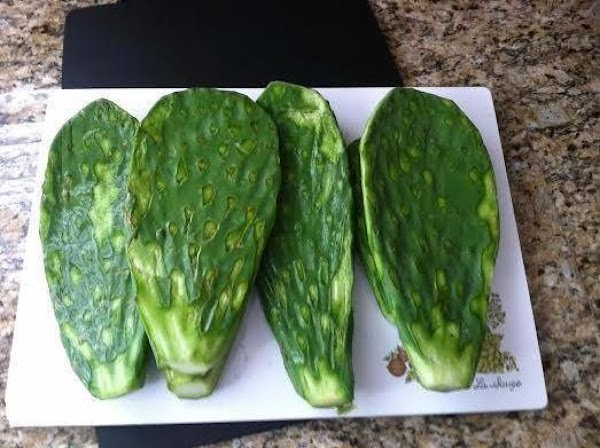 How to prepare the Nopales:  Slice up the pads first lengthwise then horizontally. You should...