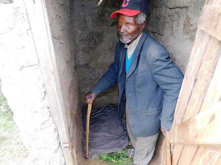 Mzee John Muiruri shows the Simba B ECD toilet where he spends the night