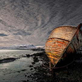 Icy Shore by Þorsteinn H. Ingibergsson - Transportation Boats ( clouds, iceland, sky, nature, wreck, structor, boat, landscape, abandoned )