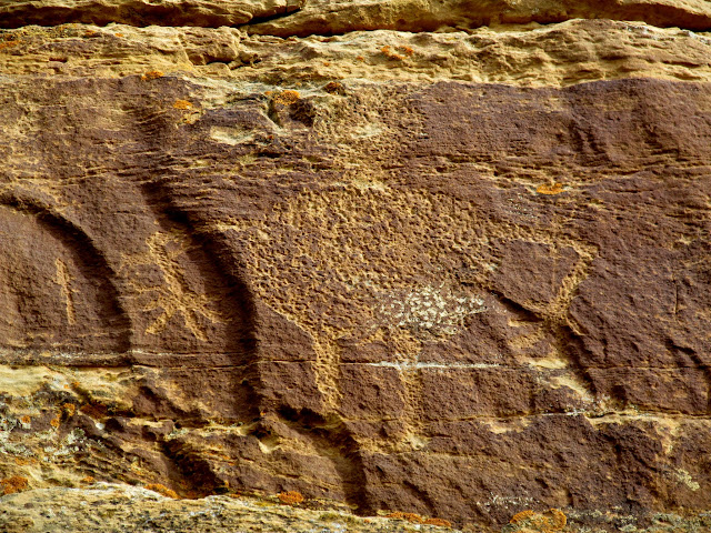 Large petroglyph high on the first cliff band