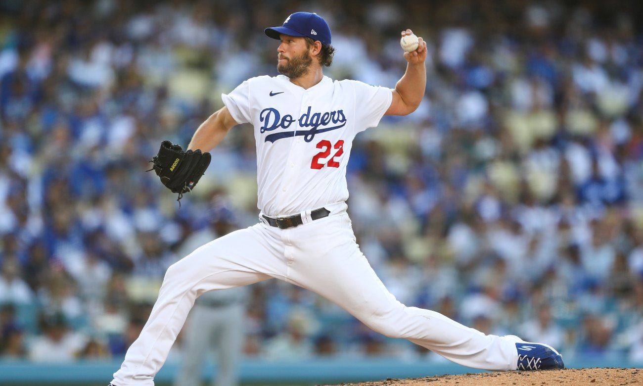 Clayton Kershaw #22 of the Los Angeles Dodgers pitches in the seventh inning against the Chicago Cubs at Dodger Stadium on June 27, 2021 in Los Angeles, California. (Photo by Meg Oliphant/Getty Images)
