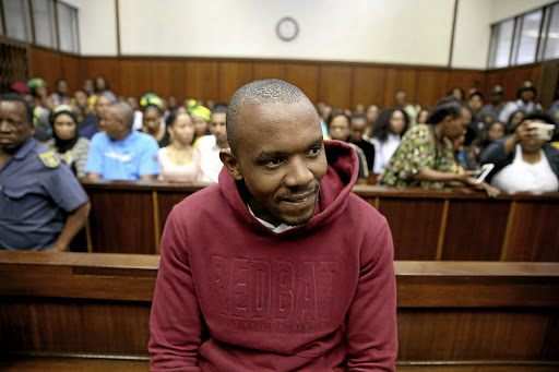 Thabani Mzolo smiles as he appears in the Durban Magistrate's Court for the murder of ex-girlfriend Zolile Khumalo.