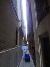 Photo: It was a narrow but very short path from the canal to our piazza