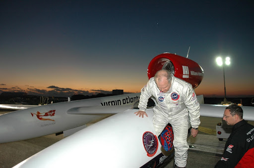 Just at dawn Steve Fossett left climbs into the Virgin Atlantic GlobalFlyer parked on NASA Kennedy Space Center's Shuttle Landing Facility.