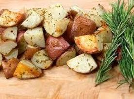 Drizzle the potatoes with olive oil and sprinkle with tarragon, salt and pepper.