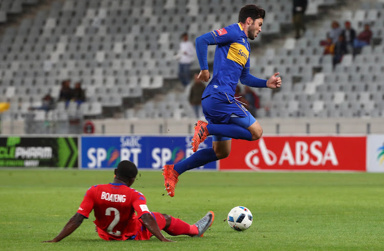 Roland Putsche of Cape Town City FC gets away from a challenge by Richard Boateng of SuperSport United during the Absa Premiership match at Cape Town Stadium, Cape Town on 14 April 2018. The match ended goalless.