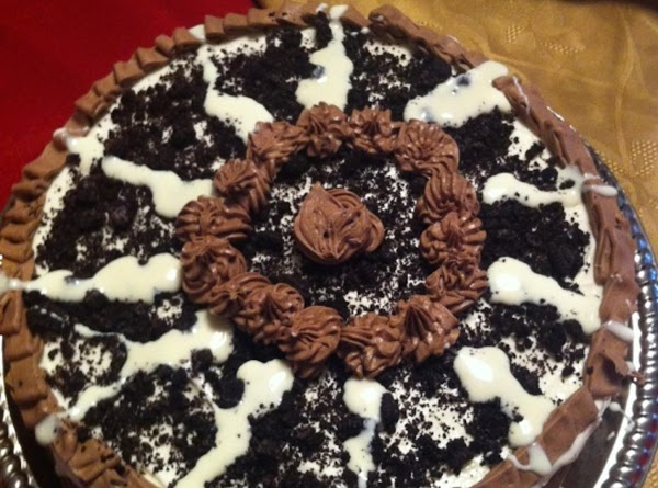 Decorate with oreo chocolate frosting, additional oreo crumbs and marshmellow topping