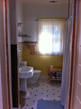 Photo: There is a second door in this bathroom that opens into the small bedroom off the dining room (the light yellow bedroom). This door is opposite the toilet.