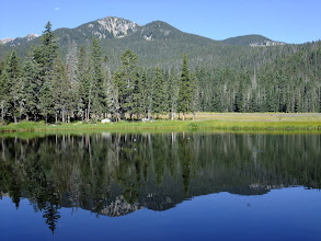Photo: Unnamed lake. The white specks over the water are swallows