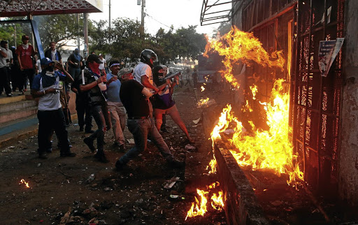Demonstrators burn the Sandinista radio station during clashes with riot police during a protest against Nicaraguan President Daniel Ortega's government, in Managua on May 30 2018. Picture: REUTERS
