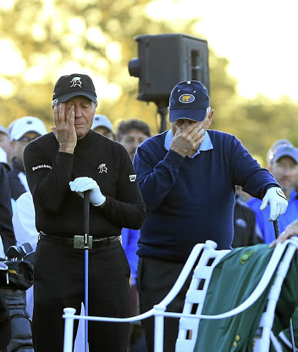 Absent friend: Honorary starters Gary Player, left, and Jack Nicklaus remember Arnold Palmer before the first round of the Masters on Thursday. Picture: ANDREW REDINGTON/GETTY IMAGES