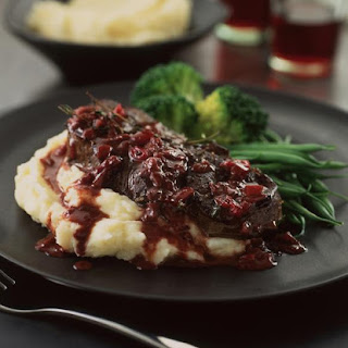 Venison Steaks with Red Currant Sauce and Garlic Mashed Potatoes.