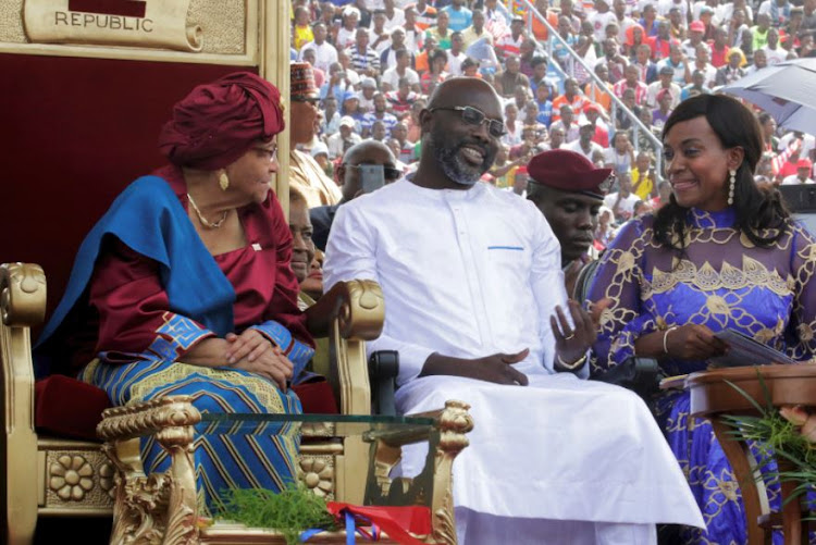 Liberia's former President Ellen Johnson Sirleaf, new President George Weah and his wife Clar are seen during his swearing-in ceremony at Samuel Kanyon Doe Sports Complex in Monrovia, Liberia January 22, 2018.
