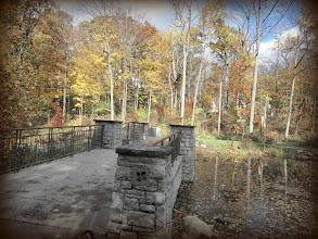 Photo: Stone bridge over autumn pond at Hills and Dales Metropark in Dayton, Ohio.
