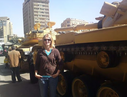 After the Egyptian Revolution Expat Blonde Girl Posed in front of a Tank
