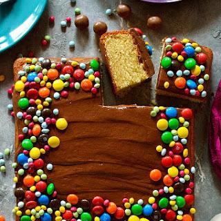 Yellow Vanilla Cake With Chocolate Ganache Frosting.