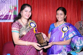 Photo: Dr. P. Uma Devi, Convener honoring Smt. V. APARNA - Chief Patron of Seminar