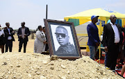 A portrait of Jabulani 'HHP' Tsambo is perched on his grave after his burial at Mahikeng's Heroe's Acre on Saturday.