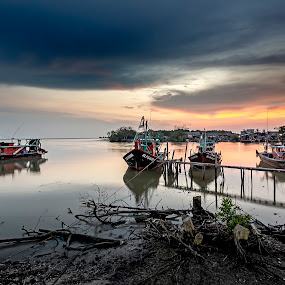 Cape of Corals Village by Coolvin Tan - Landscapes Waterscapes ( clouds, fishermen, village, waterscape, sunset, sea, malaysia, boat )