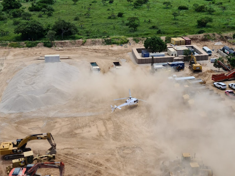 A Dyck Advisory Group helicopter lands in Palma, Mozambique, in this picture taken between March 24 and March 27 2021. Total has withdrawn all its staff from its Afungi natural gas project site in northern Mozambique.