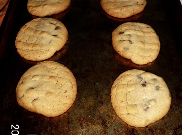 """Flatten combined balls with spatula.  Place 2"""" apart on greased cookie sheet. ..."""