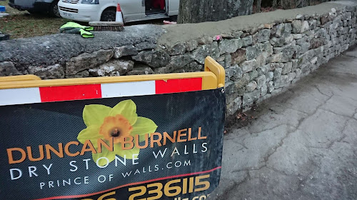 Repairing road fronting walls with National Trust in Bath