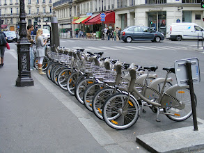 Photo: A typical example of one of the 1450 Velib stations in the city, with subscribers picking up and leaving bicycles, as controlled by the electronic station at the left. While there are many stations, the logistics and bicycle distribution are of course not perfect: some stations like this are completely full (perfect for starting, not good for returning), and we see others which are entirely empty. I'm sure that the increasingly-experienced users are adept at managing all this.