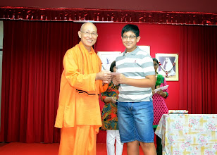 Photo: Aryan Garg, who has done well in PSLE, receiving the Award from Swamiji
