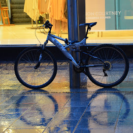 Reflective bike by Des McKenna - Transportation Bicycles ( reflection, shop window, wheels, rain, bicycle,  )