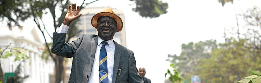 Vindicated: Kenyan opposition leader Raila Odinga waves at supporters as he leaves the Supreme Court in Nairobi