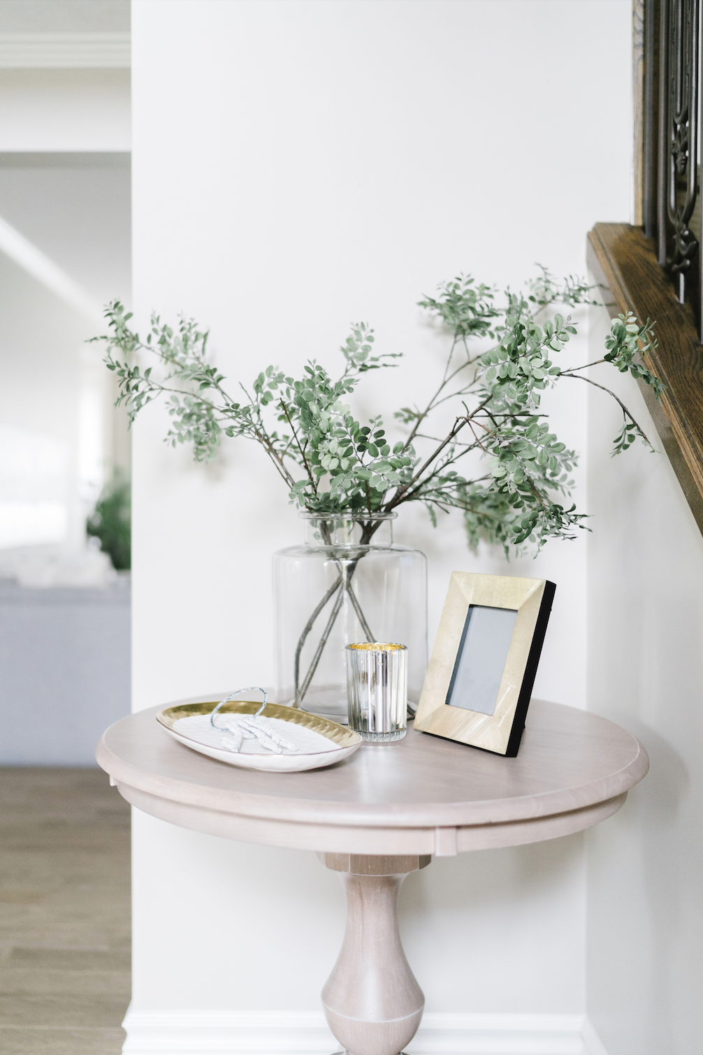 leanne bunnell interiors calgary vignette round pink table gold frame plant accessories