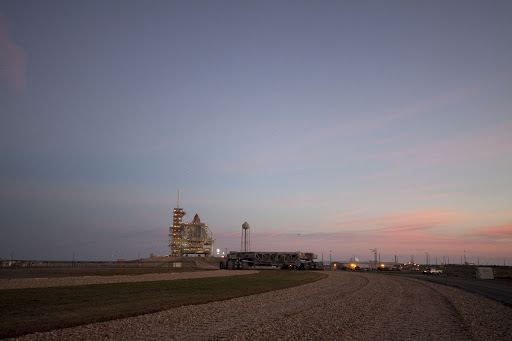 Dawn breaks over the Atlantic Ocean near Launch Pad 39A to reveal space shuttle Discovery arrived for its launch.