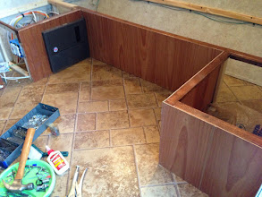"""Photo: Dinette Mod: Reused wood panels from original benches, but had to use a few new pieces. """"Cinnamon"""" from Lowes. Pretty close."""