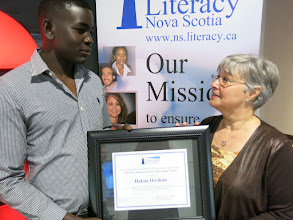 Photo: Hakim Ibrahim is the first recipient of the Gary Mason Learner Achievement Award, which was presented to him by Gary's wife Janice Mason on June 21, 2016.
