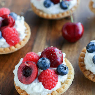 Berry Tarts with Sweet Goat Cheese Mousse.