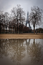 Photo: My girlfriend and I went to Paris a couple of weekends ago. We've both been a few times before so the agenda was more to enjoy the food, wine and ambience than to do too much running around playing tourist.  We did do a brief walk by of the Eiffel Tower, however with the overcast and drizzly conditions it was hardly at its most spectacular. The cloud was so low it was frequently engulfing the top of the tower. Interestingly that didn't seem to discourage the throngs of tourists still queueing to go to the top! I suppose for many of them they wouldn't get another chance so were trying to make the most of it. I felt a bit the same when I took this photo - shortly after this we had to rush off to catch our train home.  Tonight I'm heading off to visit friends and family in New Zealand for my first summer Christmas in maybe 6 or 7 years. Have a very Merry Christmas everyone!