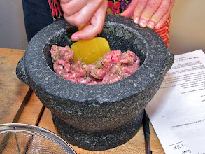 Photo: mixing ground pork with the garlic-pepper-cilantro root paste